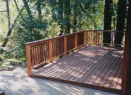 a deck in the forest redwood railing and trex composite decking