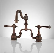 What To Look For In A Kitchen Faucet Functional Rubbed Bronze Kitchen Faucet With The Warmth Of