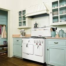 kitchen white hoods above simple shelf on white backsplash near