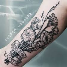 traditional flower bouquet tattoo looks like it u0027s got a carnation