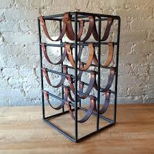 arthur umanoff wrought iron and leather strap wine rack at 1stdibs