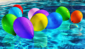 purple yellow and blue balloon on swimming pool free stock photo