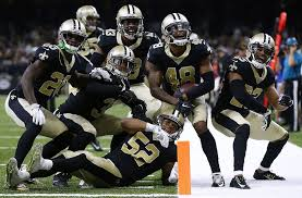 saints win smack down lions 52 38 in barn burner