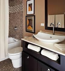 bathroom using hanging glass pendants over vanity with vessel