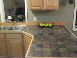 light and dark brown tile countertop and backsplash white
