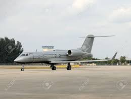 Luxury Private Jets Luxury Private Jet In Gray Color Arriving At Destination Stock