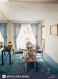 Carpeted Dining Room 1970s Retro Dining Room Pale Blue Drapes Carpeting Dining Table