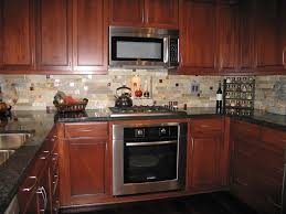 beige kitchen backsplash tile combined with wooden cabinets and