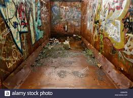 interior of an empty vandalised shipping container stock photo