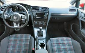 the new vw golf gti maintains its trademark plaid cloth upholstery