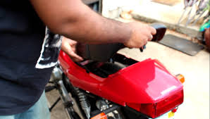 how to remove seat and charge the battery on a honda cb250