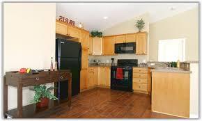 maple kitchen cabinets with dark wood floors kitchen cabinets