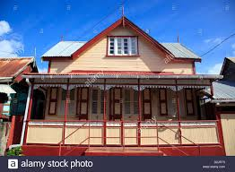 traditional wooden house with dormer windows and porch in vieux