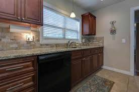 best color to paint kitchen with cherry cabinets what color paint to tone the cherry cabinets