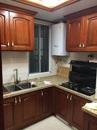 how to clean oak kitchen cabinets l shaped unfinished oak solid wood door cleaning kitchen