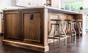 walnut kitchen island walnut island with swivel industrial stools transitional