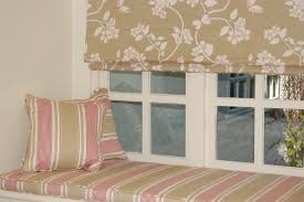 diana murray interiors bedroom with roman blinds and window seat