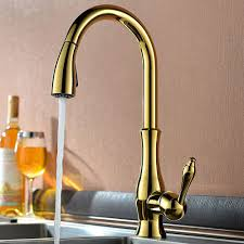 deck mounted kitchen sink faucet with pull down spray moravia is a stylish kitchen faucet available in three different finishes brushed nickel gold and oil rubbed bronze it is a tall faucet and it comes