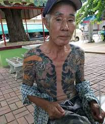 yakuza boss arrested after photo of tattoos go viral daily mail