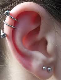 earring that connects to cartilage cartilage piercing aftercare complications jewelry