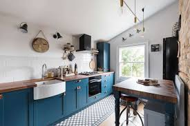 blue kitchen cabinets with wood countertops here s how to organize a small kitchen without a pantry