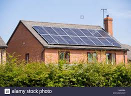 solar panels on roof solar panels on roof of modern detached house in rural village of