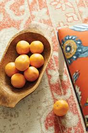 we re loving citrus colors how to decorate shop found european dough bowls kalahari printed woven rug tory spice fabric by the yard ballard designs and more