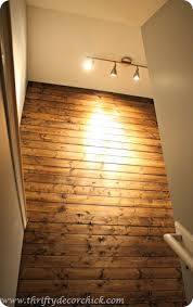diy wood planked wall from thrifty decor