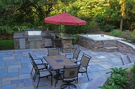 Backyard Stone Patio Designs by Stone Patio And Tub The Natural Stone Walls And Patio Create