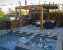 pool construction with outdoor kitchen and interlocking m e