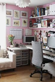 home office decorated with wall pictures and pink walls with open