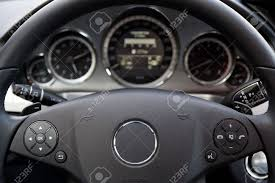car dashboard modern car dashboard focus on steering wheel stock photo