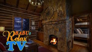 cozy log cabin wind crackling fireplace sounds and snow falling