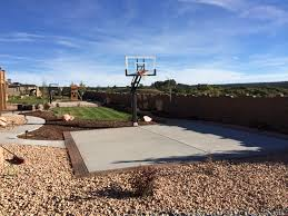 this is a great picture of a backyard basketball court