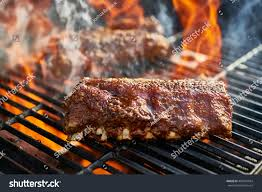 grilling baby back pork ribs over stock photo 499947034 shutterstock
