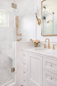 white and gold bathroom features a white washstand adorned with