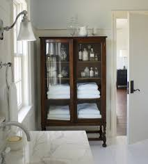 bathroom linen closet ideas i love the look of a wood cabinet in a washroom it adds such a