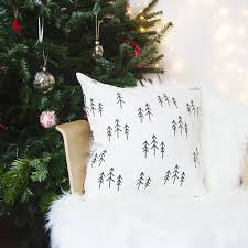 scandinavian christmas cushion with tree pattern by emodi