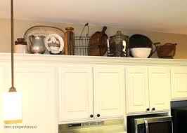ideas for tops of kitchen cabinets decorating above kitchen cabinets cabinet design decorating above