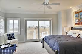 sherwin williams sea salt for a beach style bedroom with a wall