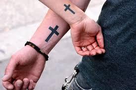 adem ayem cross tattoos on wrist for