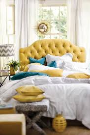 best 25 yellow headboard ideas on pinterest blue yellow yellow tufted headboard with blue velvet pillows and white linens