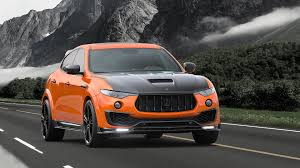 mansory to make the bentley mansory tuned a maserati levante and the result is very orange