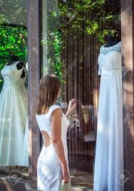 dreaming of wedding dress admiring beautiful white wedding dress