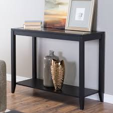 shelby glass top console table with quatrefoil underlay hayneedle