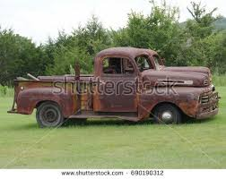 rusty pickup truck rusty old pickup truck shattered windshield stock photo royalty