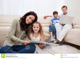 family spending leisure time in the living room royalty free stock