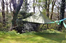 a hammock style tent suspended from trees by alex shirley smith