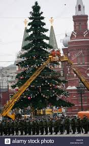decorating a huge christmas tree in front of the state history