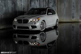 bmw stanced or not stanced bmw x1 poses inside abandoned warehouse